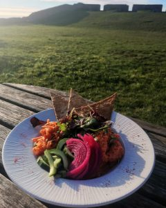 Vegan salad bowl on a table outside the Guardhouse Cafe